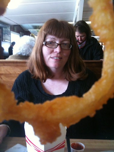 my sister, as seen through a Woodmans onion ring.